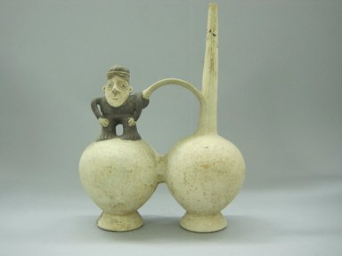 Chancay. <em>Whistling Vessel with Figure of a Man</em>, 1000-1400. Clay, slips, 11 1/2 x 7 5/8 x 3 7/8 in.  (29.2 x 19.4 x 9.8 cm). Brooklyn Museum, Gift of the Ernest Erickson Foundation, Inc., 86.224.140. Creative Commons-BY (Photo: Brooklyn Museum, CUR.86.224.140.jpg)