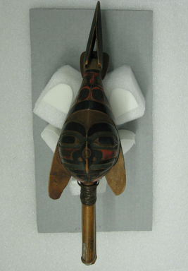 Possibly Tlingit. <em>Raven Rattle</em>, 19th century. Wood, fiber, paint, 13 1/4 x 5 3/4 x 3 3/4 in.  (33.7 x 14.6 x 9.5 cm). Brooklyn Museum, Gift of the Ernest Erickson Foundation, Inc., 86.224.154. Creative Commons-BY (Photo: Brooklyn Museum, CUR.86.224.154_view01.jpg)