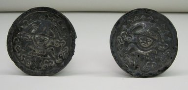 Chimú. <em>Pair of Earplugs</em>, 1000-1500. Silver, each (a+b): 1 3/4 x 2 3/8 in. (4.4 x 6 cm). Brooklyn Museum, Gift of the Ernest Erickson Foundation, Inc., 86.224.31a-b. Creative Commons-BY (Photo: Brooklyn Museum, CUR.86.224.31a-b_view2.jpg)