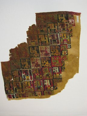 Coastal Wari (attrib by Nobuko Kajatani, 1993). <em>Mantle or Carrying Cloth Fragment</em>, 600-1000. Cotton, camelid fiber, 15 3/8 x 16 15/16 in. (39 x 43 cm). Brooklyn Museum, Gift of the Ernest Erickson Foundation, Inc., 86.224.71. Creative Commons-BY (Photo: Brooklyn Museum, CUR.86.224.71.jpg)