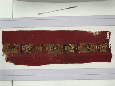 Coastal Wari (attrib by Nobuko Kajatani, 1993). <em>Mantle or Mantle Border Fragment</em>, 600-1000. Cotton, camelid fiber, 21 1/16 x 6 7/8 in. (53.5 x 17.5 cm). Brooklyn Museum, Gift of the Ernest Erickson Foundation, Inc., 86.224.72. Creative Commons-BY (Photo: Brooklyn Museum, CUR.86.224.72.jpg)