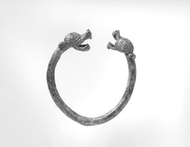 <em>Bracelet</em>, ca. 8th century B.C.E. Bronze, 1/4 x 3in. (0.6 x 7.6cm). Brooklyn Museum, Gift of the Ernest Erickson Foundation, Inc., 86.226.42. Creative Commons-BY (Photo: Brooklyn Museum, CUR.86.226.42_NegA_print_bw.jpg)