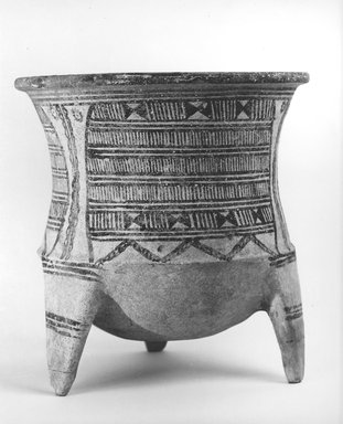 <em>Tripod Vase</em>, ca. 1600-1500 B.C.E. Clay, slip, 9 1/2 x 9 3/16in. (24.1 x 23.3cm). Brooklyn Museum, Gift of the Ernest Erickson Foundation, Inc., 86.226.58. Creative Commons-BY (Photo: Brooklyn Museum, CUR.86.226.58_NegA_print_bw.jpg)