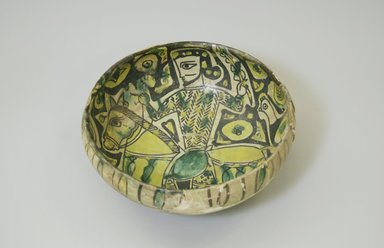<em>Bowl</em>, 10th century. Ceramic, white engobe, brown, yellow, and green slip, transparent colorless glaze, 3 3/8 x 7 7/8 in. (8.5 x 20 cm). Brooklyn Museum, Gift of the Ernest Erickson Foundation, Inc., 86.227.1. Creative Commons-BY (Photo: Brooklyn Museum, CUR.86.227.1.jpg)