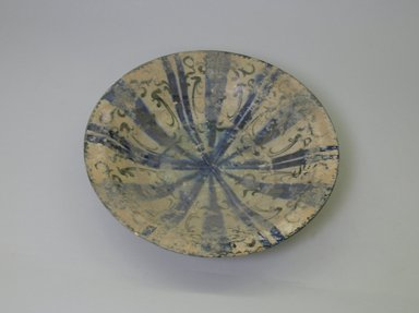 <em>Bowl</em>, 13th century. Ceramic, black and blue underglaze decoration, transparent      colorless glaze, 2 13/16 x 12 1/2 in. (7.2 x 31.8 cm). Brooklyn Museum, Gift of the Ernest Erickson Foundation, Inc., 86.227.12. Creative Commons-BY (Photo: Brooklyn Museum, CUR.86.227.12_interior.jpg)