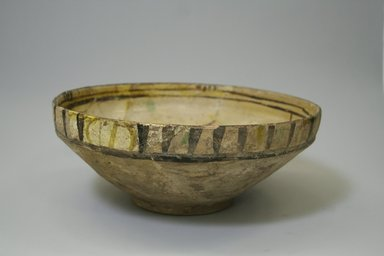 <em>Bowl</em>, 10th-12th century. Ceramic, white engobe, brown, yellow, and green slip, transparent colorless glaze, 4 1/8 x 10 1/2 in. (10.5 x 26.7 cm). Brooklyn Museum, Gift of the Ernest Erickson Foundation, Inc., 86.227.13. Creative Commons-BY (Photo: Brooklyn Museum, CUR.86.227.13_exterior.jpg)
