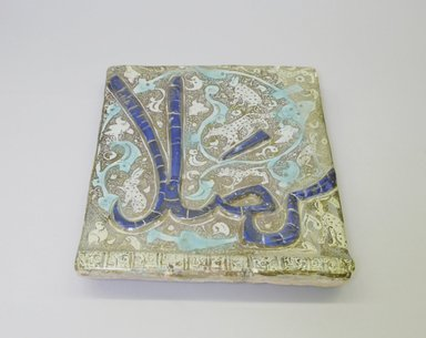 <em>Tile</em>, 13th century. Ceramic; fritware, molded, painted with cobalt-blue and turquoise under a transparent glaze, overglaze painted with luster, 9 3/8 x 1 1/16 x 10 15/16 in. (23.8 x 2.7 x 27.8 cm). Brooklyn Museum, Gift of the Ernest Erickson Foundation, Inc., 86.227.141. Creative Commons-BY (Photo: Brooklyn Museum, CUR.86.227.141.jpg)