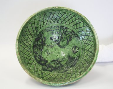 <em>Bowl</em>, 12th-13th century. Ceramic, champleve ware, transparent green glaze, 4 5/8 x 10 5/8 in. (11.8 x 27 cm). Brooklyn Museum, Gift of the Ernest Erickson Foundation, Inc., 86.227.179. Creative Commons-BY (Photo: Brooklyn Museum, CUR.86.227.179.jpg)