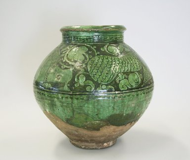 <em>Jar</em>, 12th century. Ceramic, transparent green glaze, white slip, reddish earthenware body, 8 1/16 x 8 7/8 in. (20.5 x 22.5 cm). Brooklyn Museum, Gift of the Ernest Erickson Foundation, Inc., 86.227.182. Creative Commons-BY (Photo: Brooklyn Museum, CUR.86.227.182.jpg)