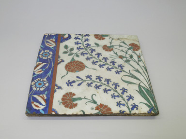 <em>Tile</em>, ca. 1575. Ceramic, transparent colorless glaze, cobalt-blue, black, and   red underglaze, off-white body, 13 1/8 x 12 13/16 in. (33.4 x 32.6 cm). Brooklyn Museum, Gift of the Ernest Erickson Foundation, Inc., 86.227.185. Creative Commons-BY (Photo: Brooklyn Museum, CUR.86.227.185.jpg)