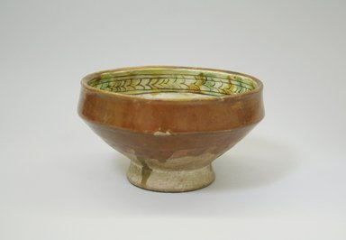 <em>Bowl</em>, 13th century. Ceramic, sgraffiato ware, reddish brown glaze, 3 9/16 x 6 3/16 in. (9 x 15.7 cm). Brooklyn Museum, Gift of the Ernest Erickson Foundation, Inc., 86.227.186. Creative Commons-BY (Photo: Brooklyn Museum, CUR.86.227.186_exterior.jpg)