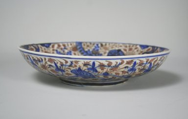 <em>Dish</em>, second half 17th century. Ceramic, lusterware, transparent colorless glaze, cobalt-blue underglaze, white frit body, 2 1/16 x 7 1/2 in. (5.2 x 19 cm). Brooklyn Museum, Gift of the Ernest Erickson Foundation, Inc., 86.227.190. Creative Commons-BY (Photo: Brooklyn Museum, CUR.86.227.190_exterior.jpg)