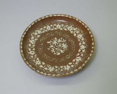 <em>Plate</em>, 18th century. Ceramic, brown slip, transparent colorless glaze, 1 7/8 x 9 1/8 in. (4.8 x 23.1 cm). Brooklyn Museum, Gift of the Ernest Erickson Foundation, Inc., 86.227.193. Creative Commons-BY (Photo: Brooklyn Museum, CUR.86.227.193_interior.jpg)