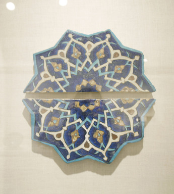<em>Ten-Pointed Star Tile</em>, mid-15th century. Ceramic; fritware, painted in cobalt blue, turquoise, and opaque white glazes with manganese purple in the cuerda seca (dry-cord) technique, with leaf gilding, 14 1/2 x 1 1/4 x 15 in. (36.8 x 3.2 x 38.1 cm). Brooklyn Museum, Gift of the Ernest Erickson Foundation, Inc., 86.227.196a-b. Creative Commons-BY (Photo: Brooklyn Museum, CUR.86.227.196.jpg)