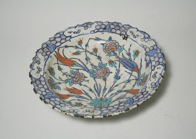 <em>Plate</em>, ca. 1560. Ceramic, cobalt-blue, turquoise, red and white glazes, 2 13/16 x 12 3/16 in. (7.1 x 31 cm). Brooklyn Museum, Gift of the Ernest Erickson Foundation, Inc., 86.227.201. Creative Commons-BY (Photo: Brooklyn Museum, CUR.86.227.201_top.jpg)
