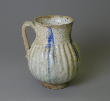 <em>Jug</em>, 12th century. Ceramic, glaze, 6 x 4 13/16 in. (15.2 x 12.2 cm). Brooklyn Museum, Gift of the Ernest Erickson Foundation, Inc., 86.227.22. Creative Commons-BY (Photo: Brooklyn Museum, CUR.86.227.22_view1.jpg)