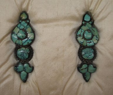 <em>Pair of Earrings</em>, 17th or 18th century. Silver inlaid with turquoise, 1 1/2 × 1 × 4 in. (3.8 × 2.5 × 10.2 cm). Brooklyn Museum, Gift of the Ernest Erickson Foundation, Inc., 86.227.43a-b. Creative Commons-BY (Photo: Brooklyn Museum, CUR.86.227.43a-b.jpg)