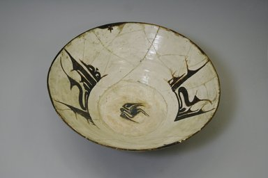 <em>Bowl</em>, 10th century. Ceramic, white engobe, brown slip, transparent colorless glaze, 4 1/8 x 12 3/8 in. (10.5 x 31.5 cm). Brooklyn Museum, Gift of the Ernest Erickson Foundation, Inc., 86.227.5. Creative Commons-BY (Photo: Brooklyn Museum, CUR.86.227.5.jpg)