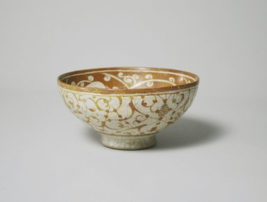 <em>Bowl</em>, late 12th century. Ceramic, lusterware, white frit body, 2 13/16 x 5 9/16 in. (7.1 x 14.2 cm). Brooklyn Museum, Gift of the Ernest Erickson Foundation, Inc., 86.227.62. Creative Commons-BY (Photo: Brooklyn Museum, CUR.86.227.62_exterior.jpg)
