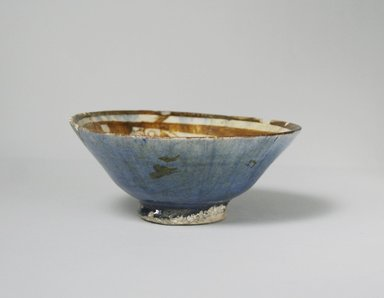 <em>Bowl</em>, late 12th-early 13th century. Ceramic, lusterware, transparent blue glaze on exterior, 2 1/4 x 5 11/16 in. (5.7 x 14.4 cm). Brooklyn Museum, Gift of the Ernest Erickson Foundation, Inc., 86.227.64. Creative Commons-BY (Photo: Brooklyn Museum, CUR.86.227.64_exterior.jpg)
