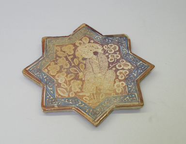 <em>Eight-Pointed Star Tile</em>, ca. 1310. Ceramic, lusterware, with turquoise underglaze decoration, 8 1/4 x 9/16 x 8 1/4 in. (21 x 1.4 x 21 cm). Brooklyn Museum, Gift of the Ernest Erickson Foundation, Inc., 86.227.73. Creative Commons-BY (Photo: Brooklyn Museum, CUR.86.227.73.jpg)