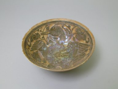 <em>Bowl</em>, mid-12th century. Ceramic, transparent bluish glaze, black slip, white engobe,    buff earthenware body, 3 1/2 x 7 3/8 in. (8.9 x 18.7 cm). Brooklyn Museum, Gift of the Ernest Erickson Foundation, Inc., 86.227.76. Creative Commons-BY (Photo: Brooklyn Museum, CUR.86.227.76_interior.jpg)