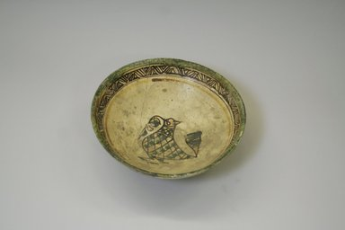 <em>Bowl</em>, 10th-12th century. Ceramic, brown, green and yellow slip, transparent colorless    glaze, 3 1/4 x 8 5/8 in. (8.2 x 21.9 cm). Brooklyn Museum, Gift of the Ernest Erickson Foundation, Inc., 86.227.86. Creative Commons-BY (Photo: Brooklyn Museum, CUR.86.227.86.jpg)