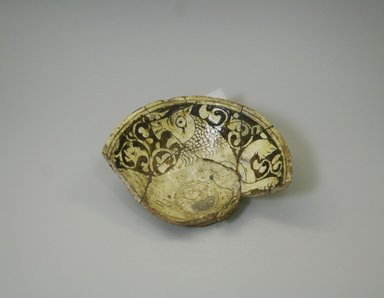 <em>Fragment of a Bowl</em>, 12th-13th century. Ceramic, champleve ware, white slip, transparent colorless glaze, 2 5/16 x 6 7/8 in. (5.8 x 17.5 cm). Brooklyn Museum, Gift of the Ernest Erickson Foundation, Inc., 86.227.87. Creative Commons-BY (Photo: Brooklyn Museum, CUR.86.227.87.jpg)