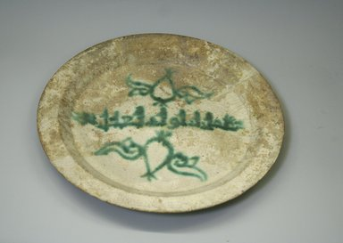 <em>Plate</em>, 9th-10th century. Ceramic, opaque white glaze, greenish turquoise decoration, yellowish body, 1 5/16 x 14 3/4 x 10 7/8 in. (3.4 x 37.4 x 27.7 cm). Brooklyn Museum, Gift of the Ernest Erickson Foundation, Inc., 86.227.88. Creative Commons-BY (Photo: Brooklyn Museum, CUR.86.227.88.jpg)