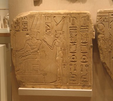 Egyptian. <em>Relief of the Theban Divine Family</em>, ca. 710-670 B.C.E. Sandstone, 28 15/16 x 31 1/8 x 1 3/4 in. (73.5 x 79 x 4.5 cm). Brooklyn Museum, Charles Edwin Wilbour Fund, 87.184.2. Creative Commons-BY (Photo: Brooklyn Museum, CUR.87.184.2_wwg8.jpg)