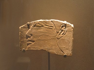<em>Face of a King</em>, ca. 1400-1390 B.C.E. Limestone, 6 11/16 x 4 9/16 in. (17 x 11.7 cm). Brooklyn Museum, Charles Edwin Wilbour Fund, 87.1. Creative Commons-BY (Photo: Brooklyn Museum, CUR.87.1_erg456.jpg)