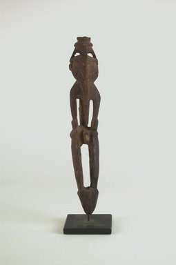 <em>Figure</em>. Wood, 7 3/4 x 1 3/8 x 1 3/8 in. (19.7 x 3.5 x 3.5 cm). Brooklyn Museum, Gift of Marcia and John Friede and Mrs. Melville W. Hall, 87.218.32. Creative Commons-BY (Photo: Brooklyn Museum, CUR.87.218.32_front_PS5.jpg)