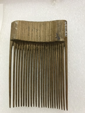 <em>Comb</em>. Bamboo, pigment, 4 5/8 x 2 3/4 in. (11.7 x 7 cm). Brooklyn Museum, Gift of Marcia and John Friede and Mrs. Melville W. Hall, 87.218.83. Creative Commons-BY (Photo: , CUR.87.218.83_back.jpg)