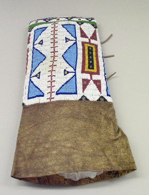 Sioux. <em>One of Pair of Woman's Legging</em>. Hide, beads, 14 15/16 × 9 1/16 in. (38 × 23 cm). Brooklyn Museum Collection, L35.199a. Creative Commons-BY (Photo: Brooklyn Museum, CUR.L35.199a_view1.jpg)