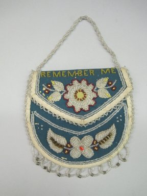 Iroquois. <em>Beaded Bag</em>, ca. 1880s. Cloth, beads, Includes fringe, excludes handle: 6 1/4 × 1/2 × 6 3/8 in. (15.9 × 1.3 × 16.2 cm). Brooklyn Museum, Gift of the Edward J. Guarino Collection in memory of Edgar and Josephine Guarino, 2016.11.10. Creative Commons-BY (Photo: Brooklyn Museum, CUR.TL2016.18.10_view1.jpg)