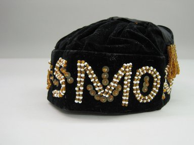 Iroquois. <em>Smoking Cap</em>, 1905. Velvet, beads, sequins, 6 1/2 × 3 3/4 × 9 in. (16.5 × 9.5 × 22.9 cm). Brooklyn Museum, Gift of the Edward J. Guarino Collection in memory of Edgar J. Guarino, 2016.11.18. Creative Commons-BY (Photo: Brooklyn Museum, CUR.TL2016.18.18_view1.jpg)