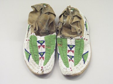 Arapaho. <em>Man's Pair of Moccasins</em>. Hide, beads, 10 1/4 x 3 15/16 in.  (26.0 x 10 cm). Brooklyn Museum, Brooklyn Museum Collection, X100a-b. Creative Commons-BY (Photo: Brooklyn Museum, CUR.X100a-b.jpg)