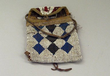 Kiowa (probably). <em>Small Bag</em>, 1850-1900. Beadwork, hide, cotton Brooklyn Museum, Brooklyn Museum Collection, X107. Creative Commons-BY (Photo: Brooklyn Museum, CUR.X107_view1.jpg)