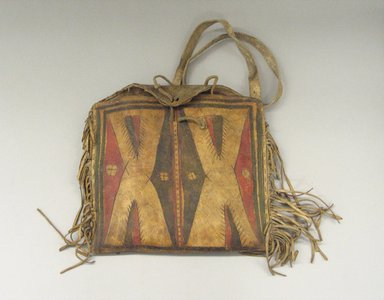 Comanche. <em>Woman's Fringed Raw Hide Bag with Strap for Carrying</em>, ca. 1900. Hide, pigment, 9 13/16 x 10 5/8 in. (25 x 27 cm). Brooklyn Museum, Brooklyn Museum Collection, X1120. Creative Commons-BY (Photo: Brooklyn Museum, CUR.X1120_view1.jpg)