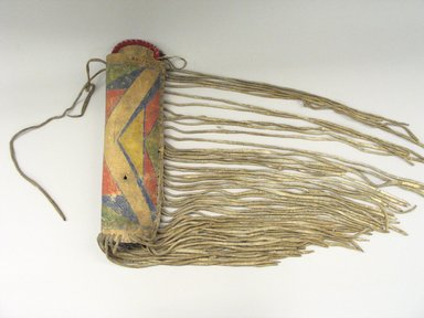 Crow. <em>Man's Personal Case</em>, 1875-1900. Hide, paint, stroud cloth, case: 16 1/2  x 5 1/2 in. Brooklyn Museum, Brooklyn Museum Collection, X1126.43. Creative Commons-BY (Photo: Brooklyn Museum, CUR.X1126.43_view1.jpg)