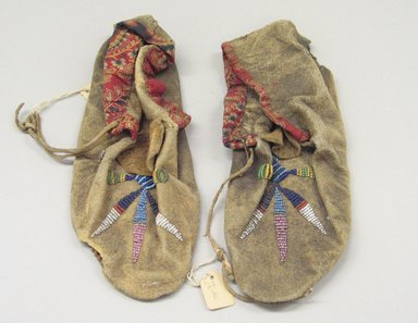 Plains. <em>Moccasins</em>, ca. 1880. Hide, cotton cloth, beads Brooklyn Museum, Brooklyn Museum Collection, X1126.7a-b. Creative Commons-BY (Photo: Brooklyn Museum, CUR.X1126.7a-b_view1.jpg)