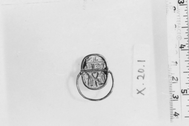 <em>Scarab</em>, ca. 1539-1292 B.C.E. Gold, steatite, glaze, 3/8 x 9/16 x 13/16 in. (1 x 1.5 x 2 cm). Brooklyn Museum, Brooklyn Museum Collection, X20.1. Creative Commons-BY (Photo: , CUR.X20.1_NegA_print_bw.jpg)