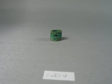 <em>Ring of Cylindrical Form</em>, ca. 1292-1075 B.C.E. Faience, 9/16 x diam. 11/16 in. (1.4 x 1.7 cm). Brooklyn Museum, Brooklyn Museum Collection, X20.4. Creative Commons-BY (Photo: Brooklyn Museum, CUR.X20.4_view1.jpg)