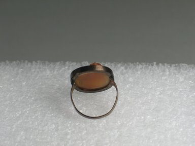 Egypto-Roman. <em>Ring with Magic Gem</em>, 1st-2nd century C.E. (probably). Carnelian, copper, gold, 7/8 x 11/16 in.  (2.3 x 1.8 cm);. Brooklyn Museum, Brooklyn Museum Collection, X20.6. Creative Commons-BY (Photo: Brooklyn Museum, CUR.X20.6_back.jpg)
