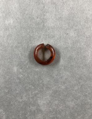 <em>Hair Ring</em>, ca. 1539-1292 B.C.E. Carnelian, depth: 3/16 in. (0.5 cm). Brooklyn Museum, Brooklyn Museum Collection, X249.52b. Creative Commons-BY (Photo: , CUR.X249.52b_view01.jpg)