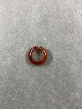 <em>Hair Ring</em>, ca. 1539-1292 B.C.E. Carnelian, depth: 3/16 in. (0.5 cm). Brooklyn Museum, Brooklyn Museum Collection, X249.52c. Creative Commons-BY (Photo: , CUR.X249.52c_view01.jpg)