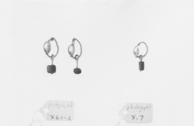 <em>Loop Earrings, Roman Type</em>, 1st-3rd century C.E. Gold, glass, diam. 1 in. (2.5 cm). Brooklyn Museum, Brooklyn Museum Collection, X6.1-.2. Creative Commons-BY (Photo: , CUR.X6.1-.2_X7_NegID_X6.1-.2_GRPA_print_bw.jpg)