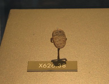 <em>Motto Scarab</em>, ca. 1630-1539 B.C.E. Steatite, glaze, 5/16 x 1/2 x 13/16 in. (0.8 x 1.3 x 2 cm). Brooklyn Museum, Brooklyn Museum Collection, X626.38. Creative Commons-BY (Photo: Brooklyn Museum, CUR.X626.38_erg2.jpg)