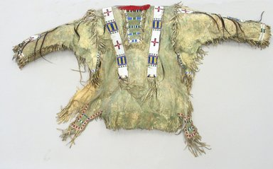 Sioux. <em>Fringed and Beaded Shirt</em>, late 19th century. Hide, beads, pigment, hair bundles, bells, wool, and feather remnants, 48 x 29in. (121.9 x 73.7cm). Brooklyn Museum, Brooklyn Museum Collection, X731.4. Creative Commons-BY (Photo: Brooklyn Museum, CUR.X731.4_view1.jpg)