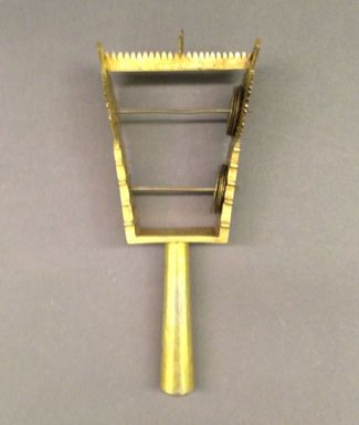 Amhara. <em>Sistrum</em>, 20th century. Brass, (23.0 x 9.0 cm). Brooklyn Museum, Brooklyn Museum Collection, X798.2. Creative Commons-BY (Photo: Brooklyn Museum, CUR.X798.2_overall_view1.jpg)